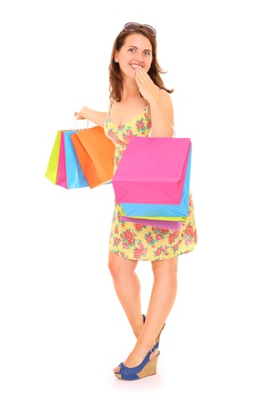 A picture of a young happy woman with shopping bags standing over white background Stock Photo - 16056492