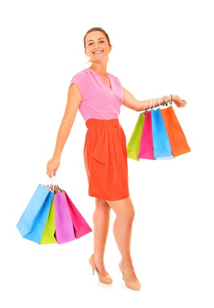 A picture of a young sexy woman with shopping bags over white background Stock Photo - 16056490