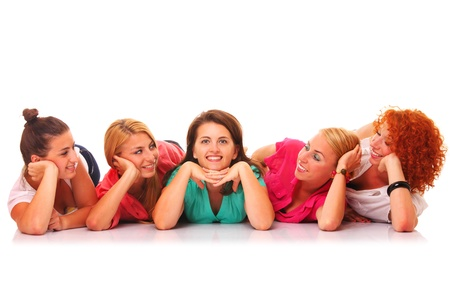 women talking: A picture of a group of girl friends smiling and lying over white background