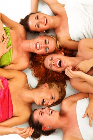 beauty spa: A picture of five girl friends having fun in spa over white background