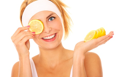 A portrait of a young beautiful woman with lemon over white background photo