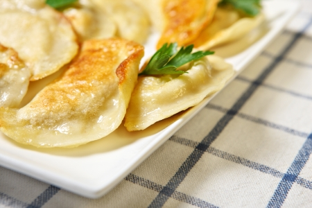 pierogi: A close up of traditional Polish dumplings on a white plate Stock Photo