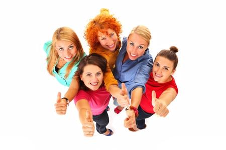 grupos de personas: Una foto de hermosas mujeres j�venes sonriendo y mostrando signo ok sobre fondo blanco