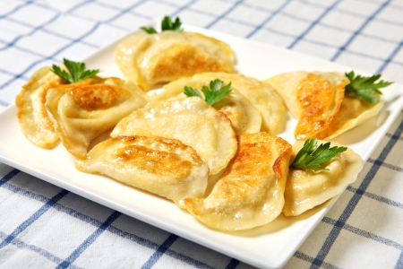A close up of traditional Polish dumplings on a white plate photo