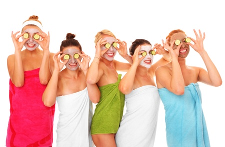 A picture of five girl friends having fun with facial masks on over white background