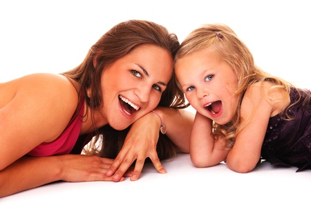 A portrait of a mother and daughter smiling over white background photo
