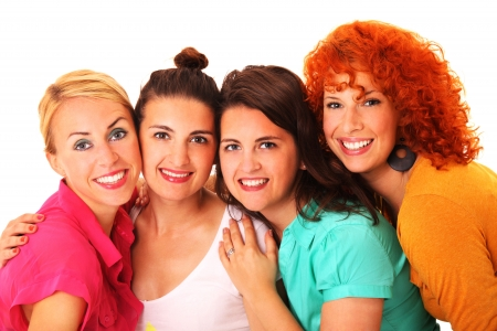 A picture of four beautiful girls standing and smiling over white background Stock Photo - 17156728
