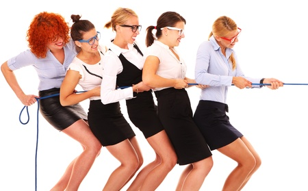 A picture of five businesswomen pulling a rope together over white background photo