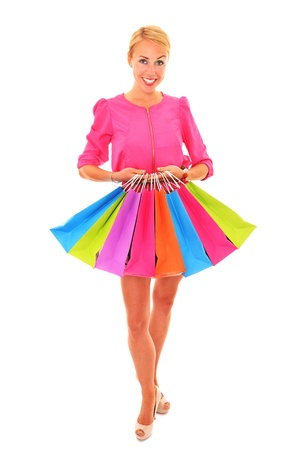 A picture of a young sexy woman with shopping bags over white background Stock Photo - 17156731
