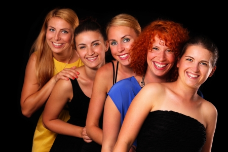 A picture of a group of five sexy girl friends posing over black background photo