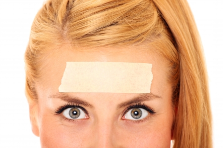 A picture of a blond woman with a tape on her forehead and space for your text Stock Photo - 17156723