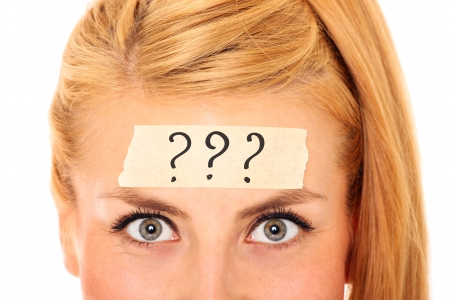 A picture of a blond woman with a tape on her forehead and and three question marks on it Stock Photo - 17156724