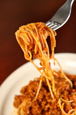 A picture of fresh spaghetti served on a white plate photo