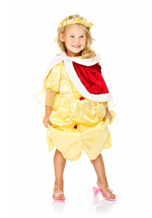 queen of angels: A portrait of a sweet little girl in a yellow dress smiling over white background Stock Photo