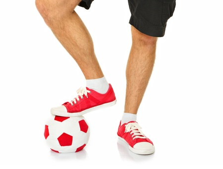 A picture of male legs holding a football over white background Stock Photo - 17283009