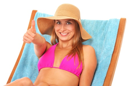 A picture of a young beautiful woman lying on a beach chair over white background Stock Photo - 17573312