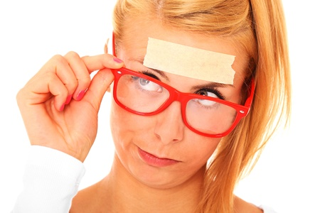 A picture of a blond confused woman with a tape on her forehead and space for your text Stock Photo - 17797128