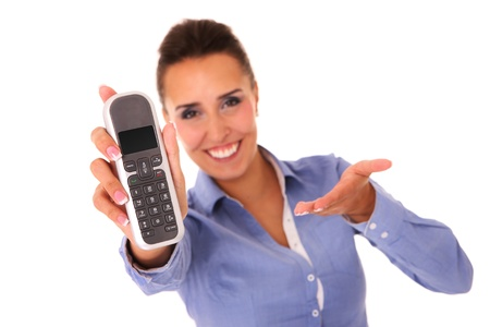 A picture of a pretty woman showing a telephone over white background Stock Photo - 17797108