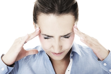 migraine: A portrait of a young woman with severe headache suffering over white background Stock Photo