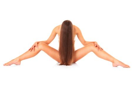 corps femme nue: Une image d'une femme sexy assise nue sur fond blanc Banque d'images