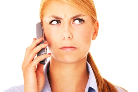 A portrait of a worried woman talking on the phone Stock Photo - 18205299