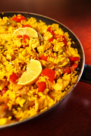 A picture of a fresh home made paella served on a frying pan photo