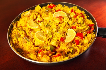 valencian: A picture of a fresh home made paella served on a frying pan Stock Photo