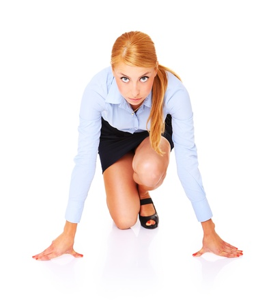A picture of a young businesswoman ready to start a race over white background photo