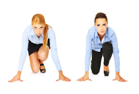 competing: A picture of a young businesswomen ready to start a race over white background