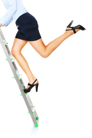 A picture of a young businesswoman climbing a ladder over whie background photo