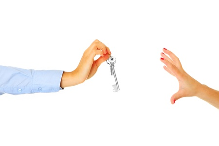 Two hands over white sharing key Stock Photo - 18494241