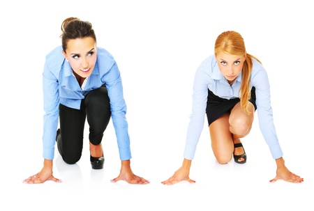 A picture of young businesswomen ready to start a race over white background photo