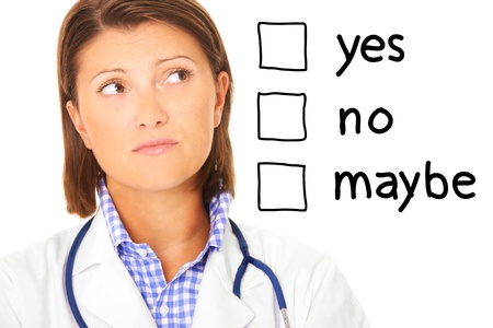 confused woman: A portrait of a young confused doctor over white background Stock Photo