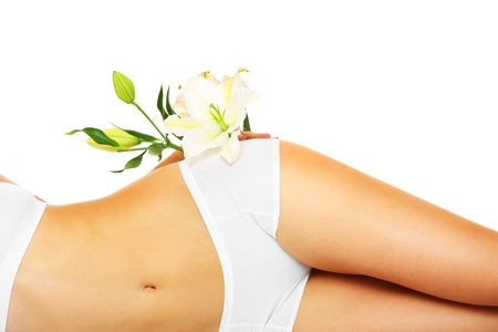 girl belly: A picture of a slim female belly and a flower over white background