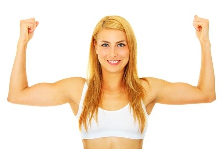 A picture of a young strong woman showing her muscles over white background photo