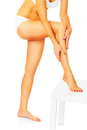 A picture of a woman showing her sexy legs over white background photo