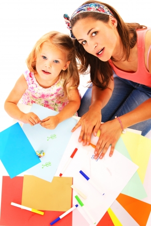 sitter: A portrait of a mother and daughter drawing together over white background
