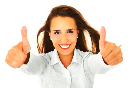 A picture of a young businesswoman showing ok sign over white background photo