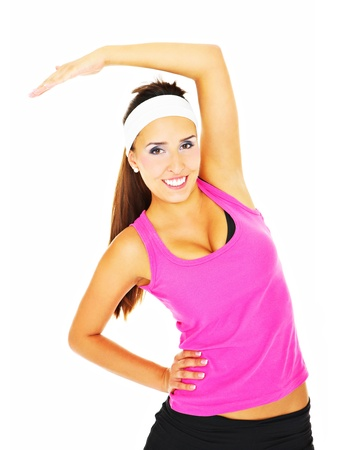A picture of a young woman stretching over white background photo
