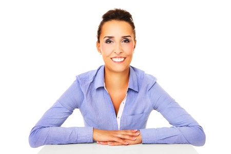 A portrait of a young successful businesswoman sitting at her desk over white background photo