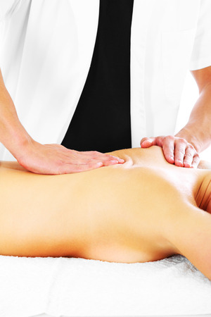A picture of a physio therapist giving a back massage photo