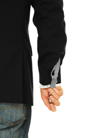 A picture of a male hand having a knife up the sleeve Stock Photo - 23447417