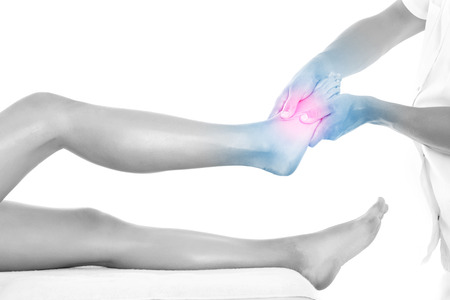 A picture of a physio therapist giving a foot massage over white background photo