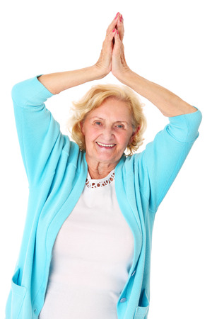 A portrait of a happy senior lady stretching over white background