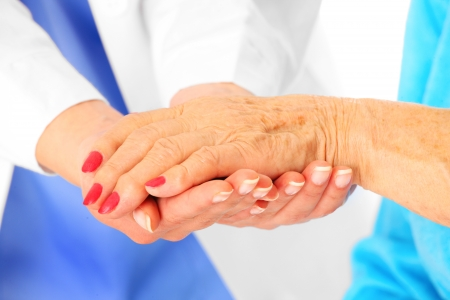 A portrait of senior hands being held by the doctor photo