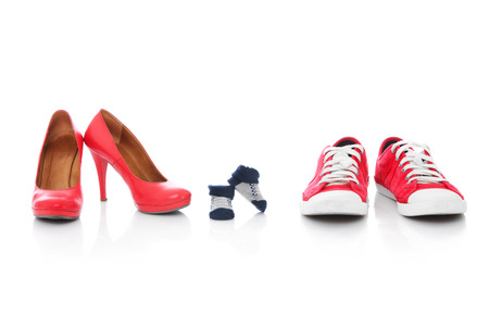 footwears: A picture of three pairs of shoes for mother father and the baby over white background