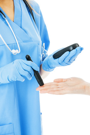 blood sugar: Midsection of female nurse examining patients blood sugar isolated over white background