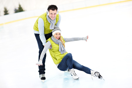 rink: A picture of a young couple ice-skating on a rink Stock Photo