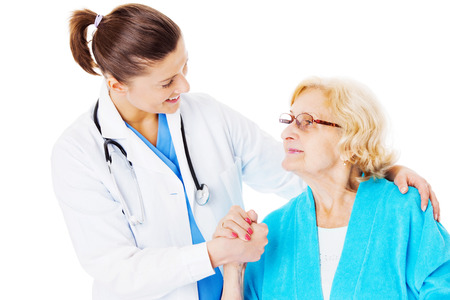 Young female doctor consoling senior woman isolated over white background Stock Photo
