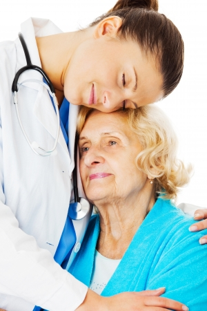 closed society: Young female doctor embracing senior woman isolated over white background